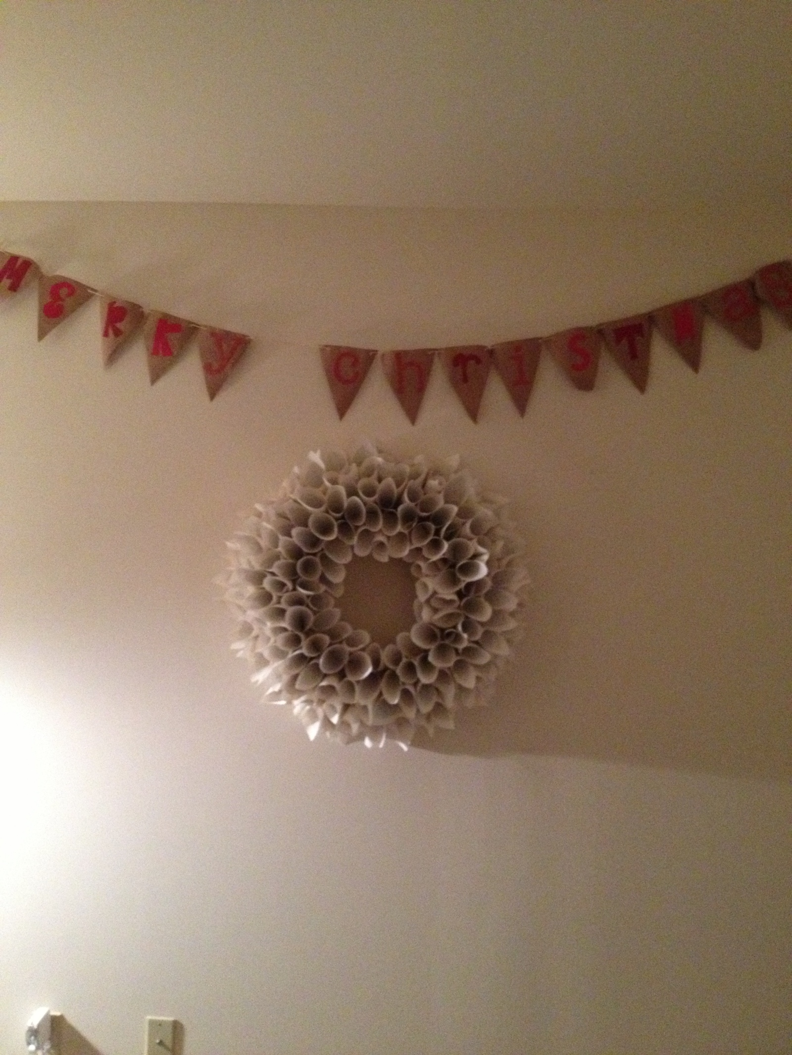 The wreath and banner on our main living room wall